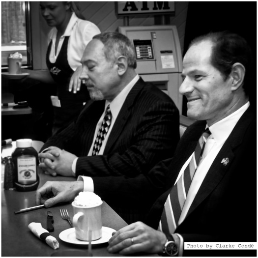 Governor Spitzer having a cup of hot chocolate.